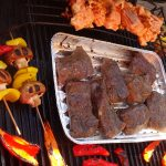barbequeing meat, fish, peppers